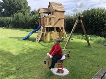 Children's Play Area includes a climbing frame, rock wall, slide, swings and a spring rocker
