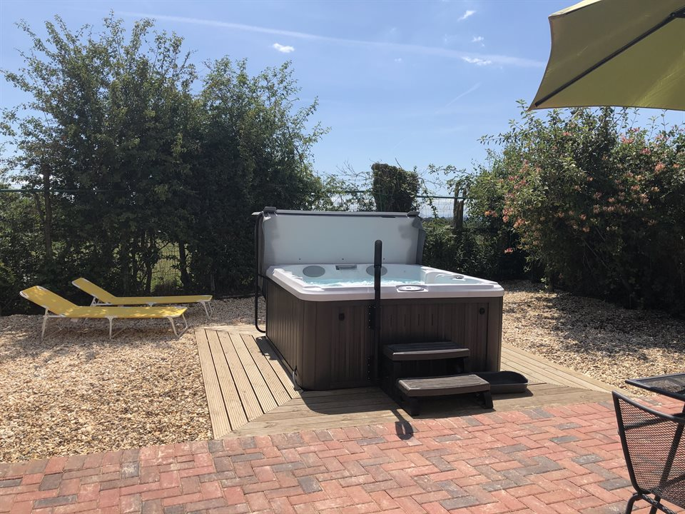 Image showing Hawthorn Lodge's private Jacuzzi 1and the private garden area with garden furniture