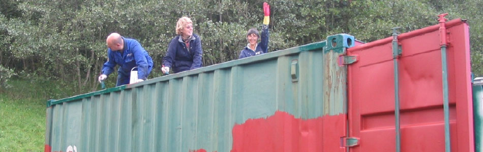Painting the container using paint provided by Procter Bros South Wales